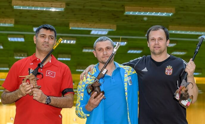 (From Left) Yusuf Dikec, Oleh Omelchuk and Damir Mikec pose after the Men's 50m Pistol finals. Photo - ISSF