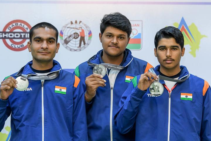 Silver medallist team of India pose with their medals after Junior Men's 10m Air Pistol.