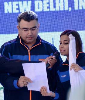 Gagan Narang and Heena Sidhu taking the oath.