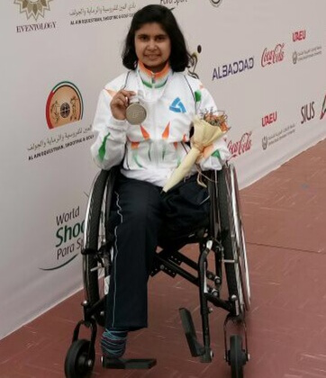 Pooja Agarwal poses with her silver medal.